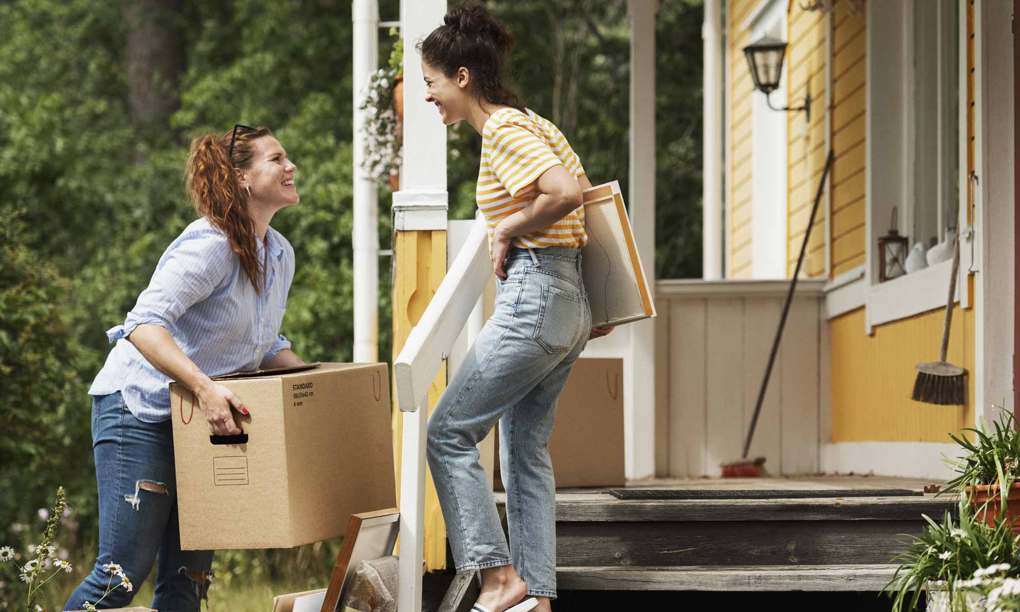 Two women with moving boxes